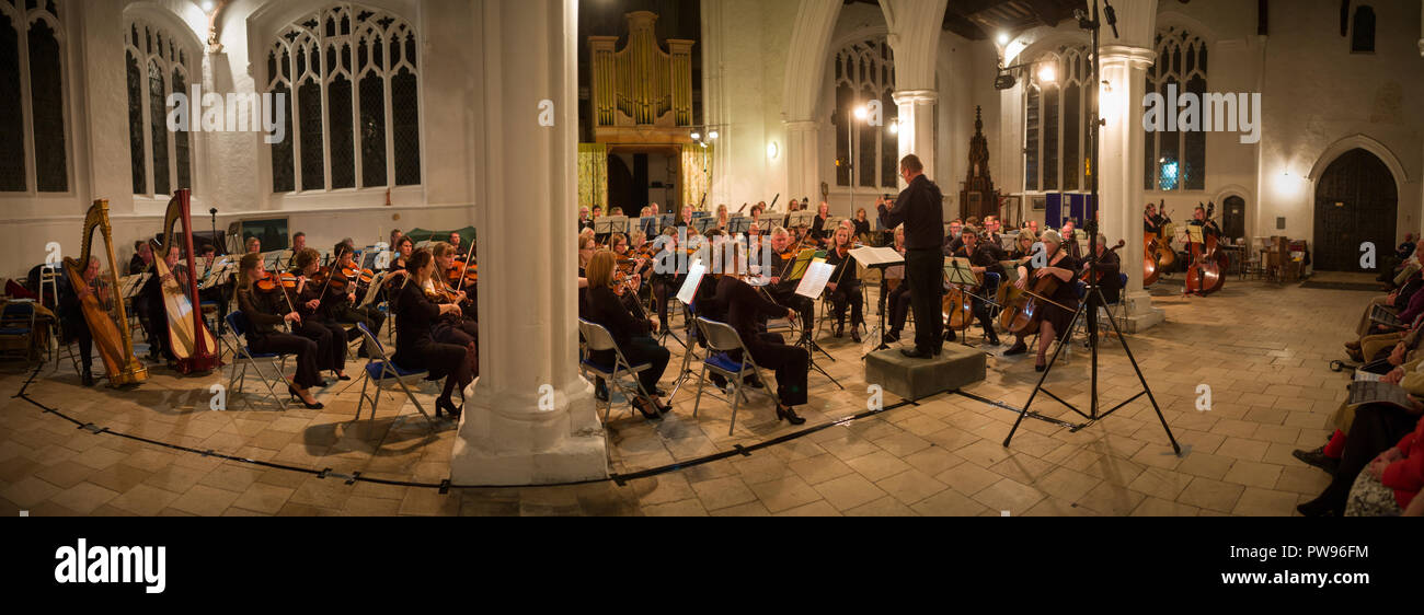 Thaxted, UK. 13th October 2018. The Centenary Performance of The Planets by Gustav Holst played by the Saffron Walden Symphony Orchestra in Thaxted Church 13 October 2018 The first performamce of The Planets was in a private performance in Queens Hall London on 29 September 1918. Gustav Holst wrote The Planets, a Suite for Large Orchestra, when he lived in Thaxted north west Essex during 1914-1915. Credit: BRIAN HARRIS/Alamy Live News - Stock Image