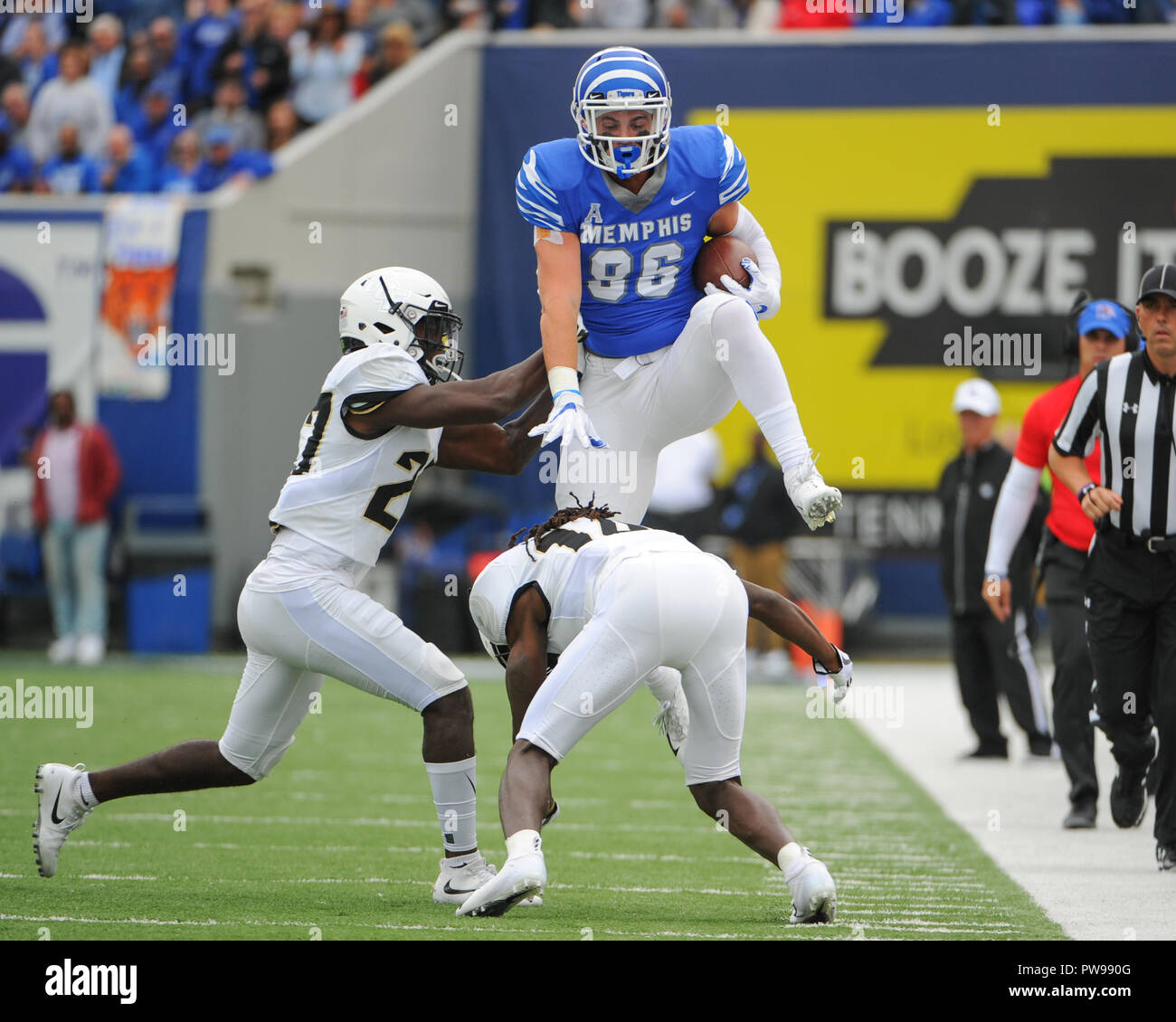 Memphis, TN, USA. 13th Oct, 2018. Memphis Tigers tight end, JOEY MAGNIFICO (86), jumps over the UCF defense during the NCAA football game between the Memphis Tigers and the Central Florida Knights at Liberty Bowl Stadium in Memphis, TN. UCF defeated Memphis, 31-30. Kevin Langley/CSM/Alamy Live News Stock Photo