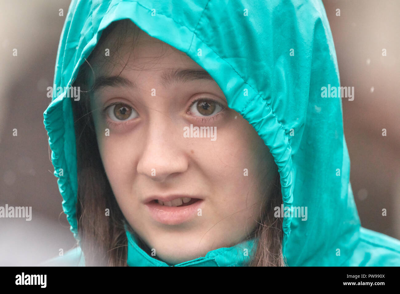 Look of disappointment on the face of a losing contestant on a very rainy day at Southwick, East Midlands, England, 14th October 2018, for the 2018 junior world conker championships. Credit: Michael Foley/Alamy Live News - Stock Image
