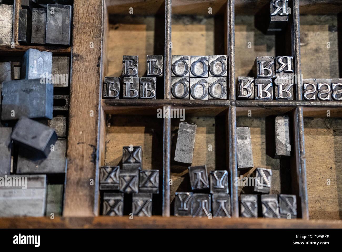 Wooden drawer of metal type blocks for printing - Stock Image