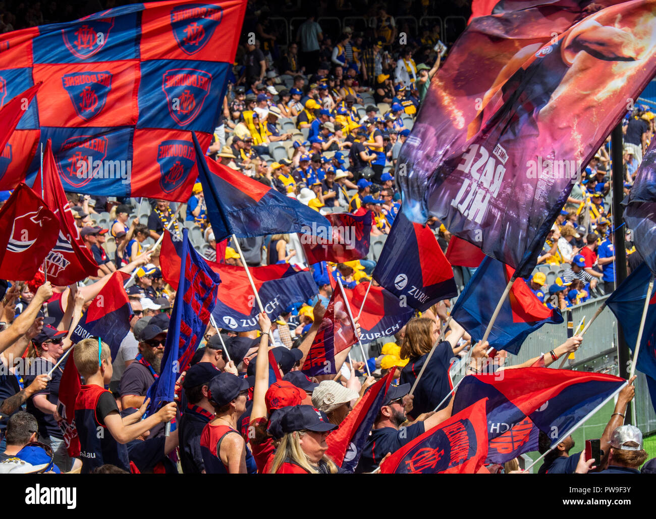 Melbourne Demons Football Club cheer squad waving flags and banners at Optus Stadium 2018 AFL Preliminary Final Perth Western Australia. - Stock Image
