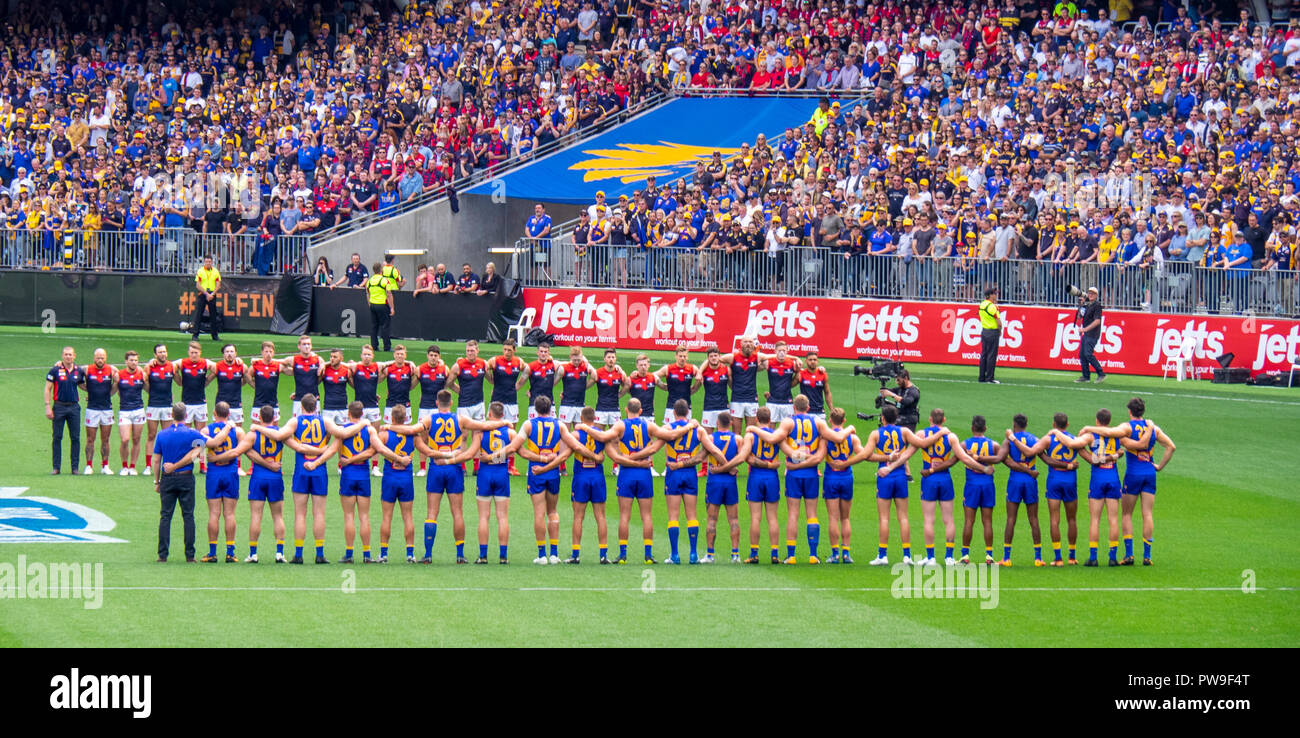 Melbourne Demons and West Coast Eagles Football Club standing pregame ceremony at Optus Stadium 2018 AFL Preliminary Final Perth Western Australia. - Stock Image