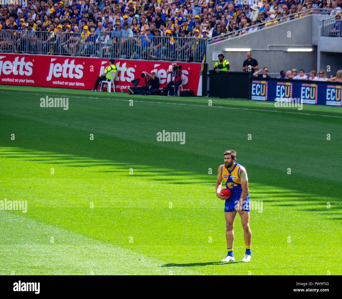 West Coast Eagles Football Club footballer Josh Kennedy about to kick the football Optus Stadium 2018 AFL Preliminary Final Perth Western Australia. - Stock Image