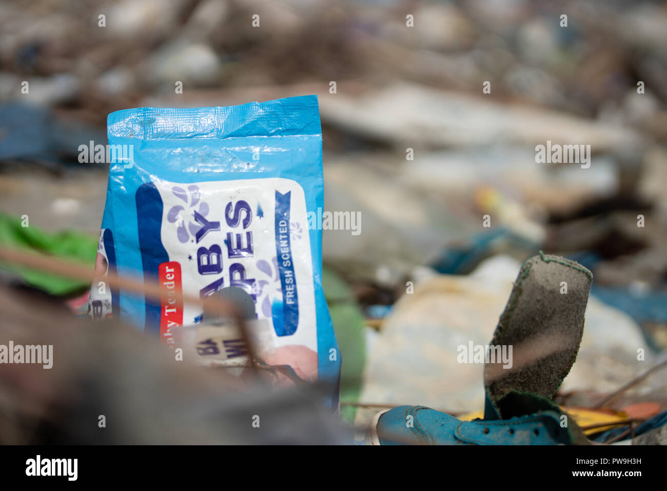 Discarded single use plastic sachets directly into the environment - regarded as one of the main plastic pollutants within South East Asia. - Stock Image