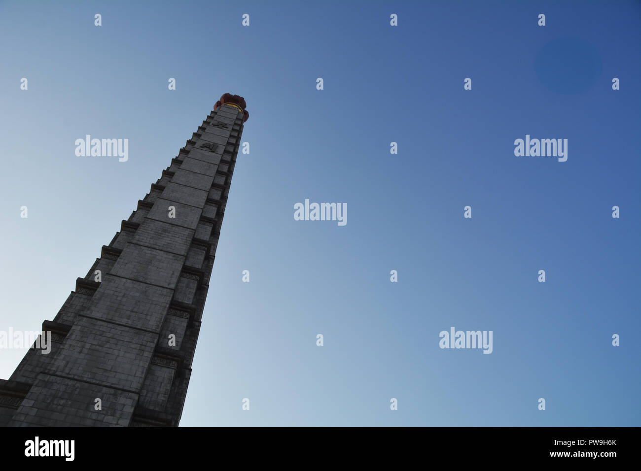 Towering into the sky, the Juche Tower, Pyongyang - Stock Image