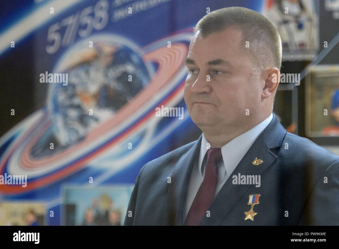 Expedition 57 Flight Engineer Alexey Ovchinin of Roscosmos stands during the State Commission meeting to approve the Soyuz launch of Expedition 57 to the International Space Stationat the Cosmonauts Hotel October 10, 2018 in Baikonur, Kazakhstan. Shortly after lift off on October 11th the rocket malfunctioned en route to the International Space Station and aborted forcing an emergency landing in Kazakhstan. The crew members have been picked up by search and rescue and are reportedly in good condition. - Stock Image