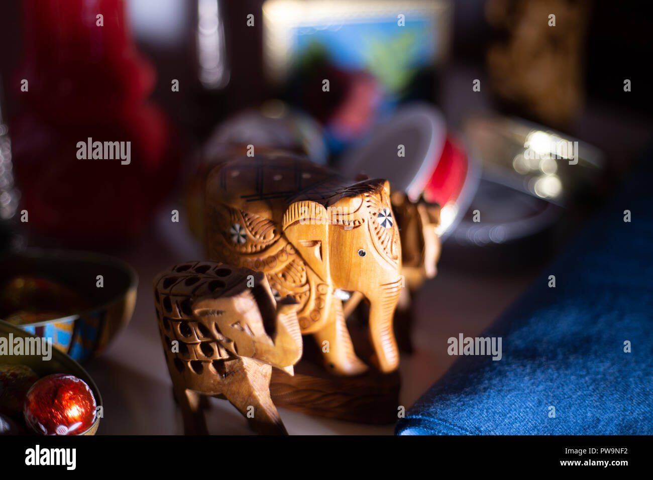 Still life of wooden elephant with festive props - Stock Image