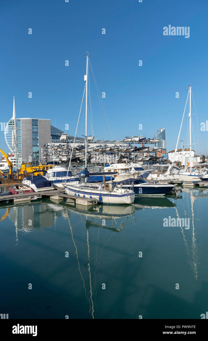 Liesure boats alongside The Camber area on Portsmouth Harbour, England, UK Spinnacker tower background. - Stock Image
