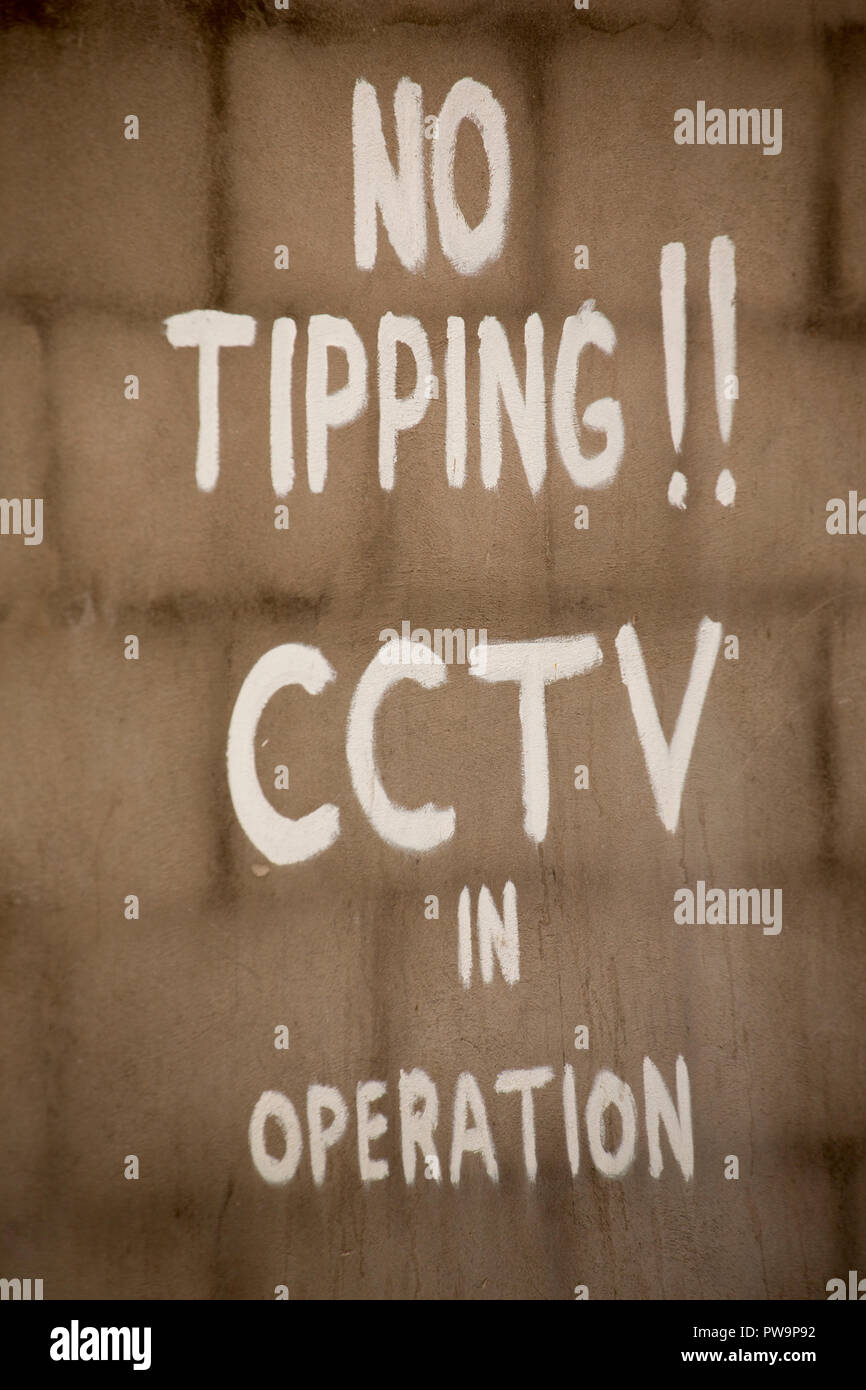 A sign warning that surveillance cameras are in operation to prevent tipping. Lancashire England UK GB - Stock Image