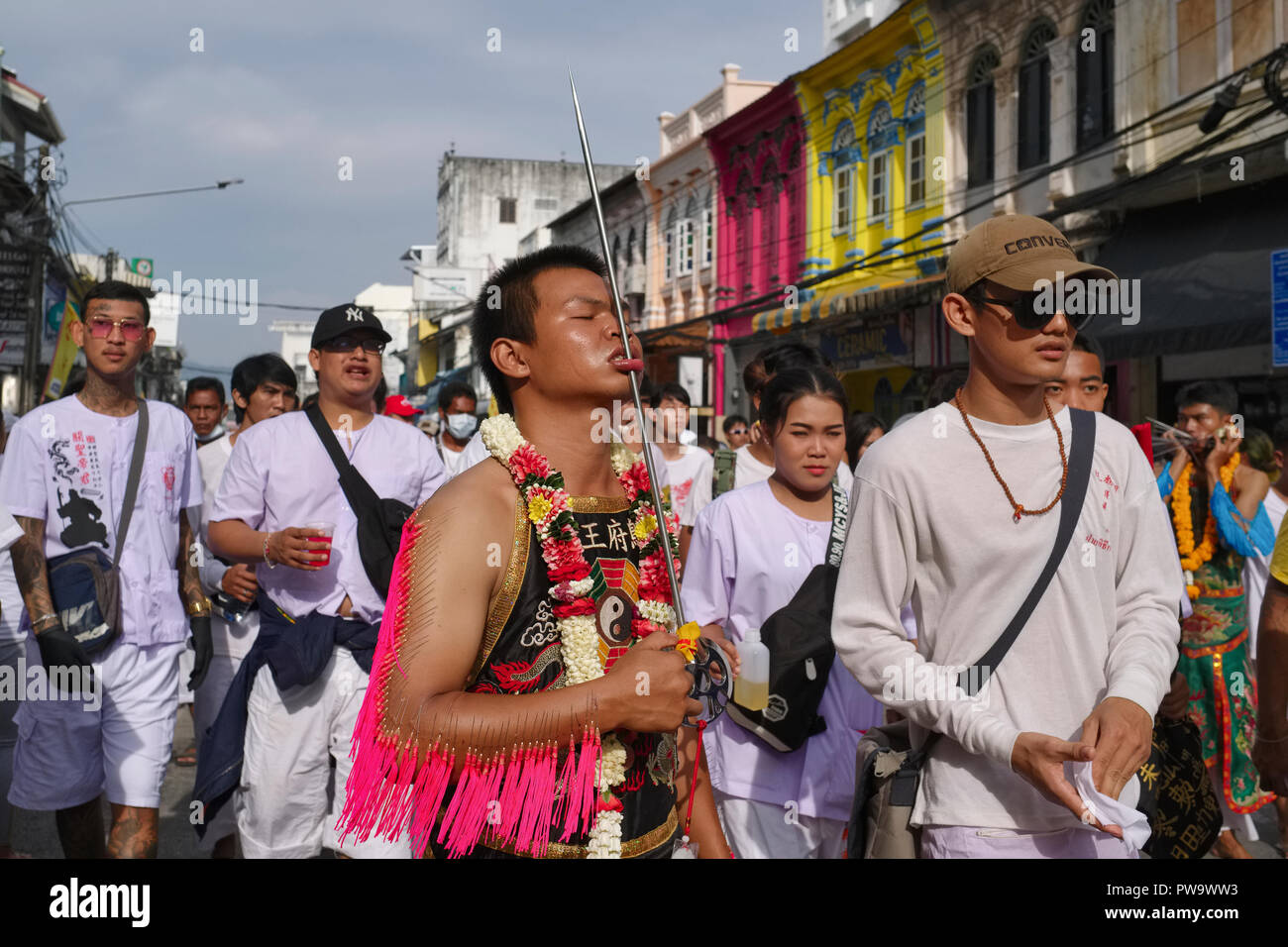 A spirit medium with his lip pierced as part of the rituals during the Vegetarian Festival in Phuket, Thailand, in procession through Phang-Nga Rd. - Stock Image