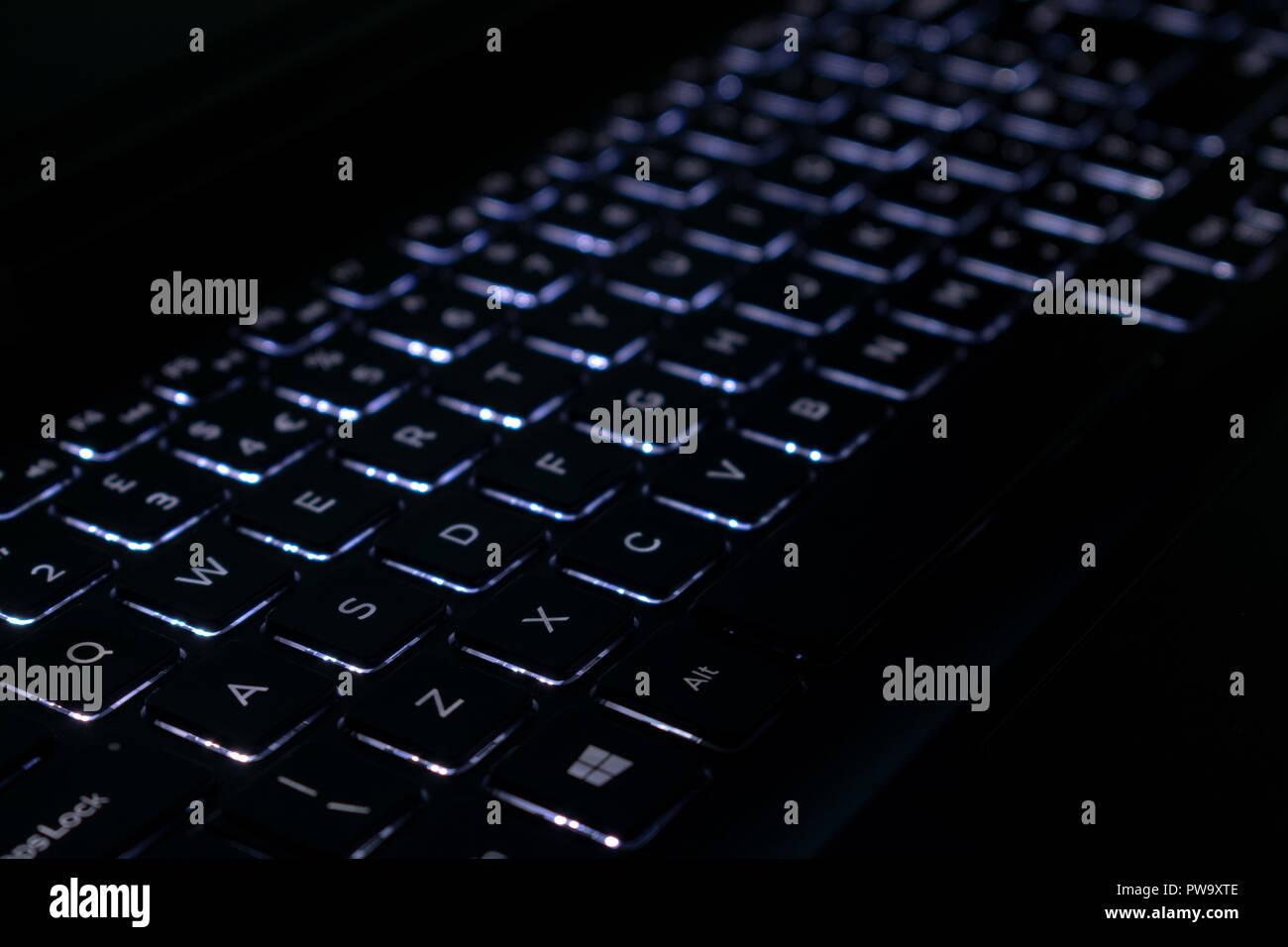 Laptop keyboard illuminated, back-lit, close up - Stock Image
