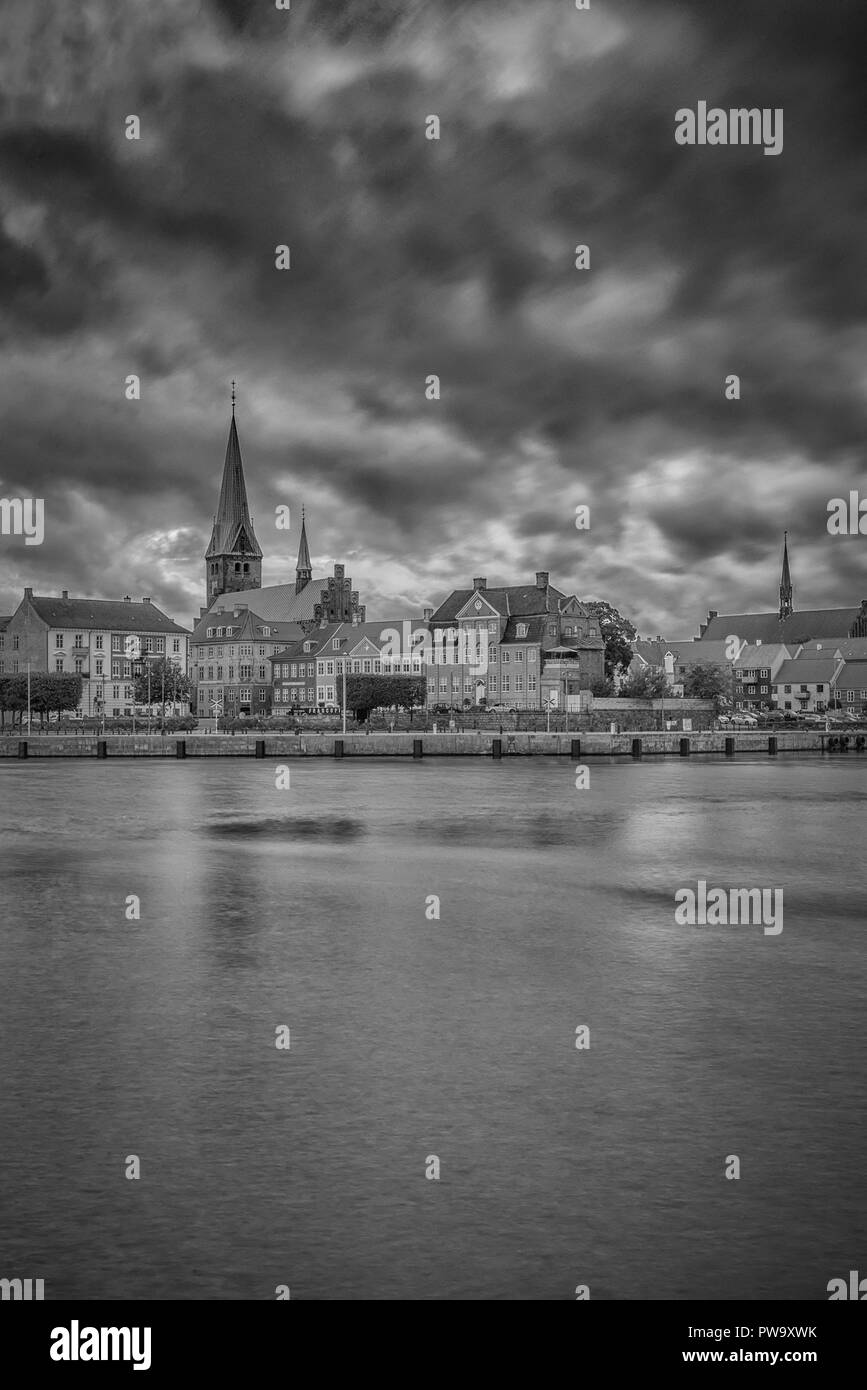The city of Helsingor in Denmark from across the harbour. - Stock Image