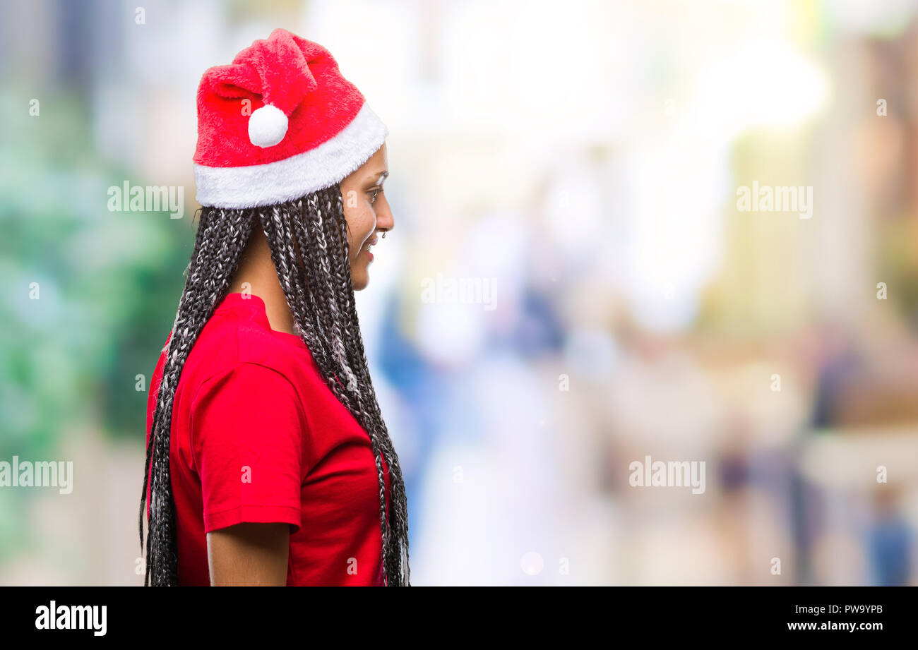 Young Braided Hair African American Girl Wearing Christmas Hat Over