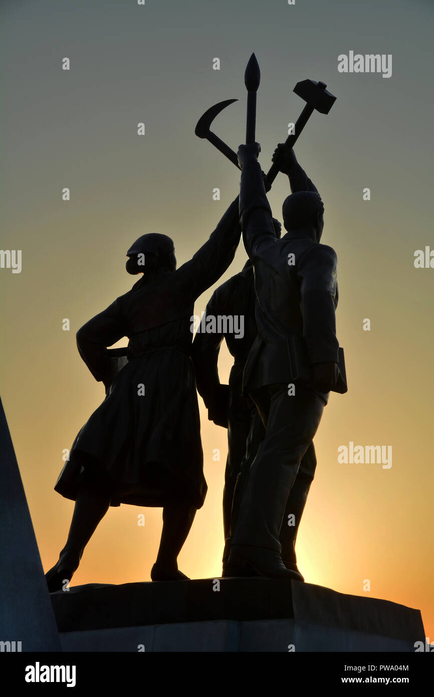 Proud statues at the base of the Juche Tower, Pyongyang - Stock Image