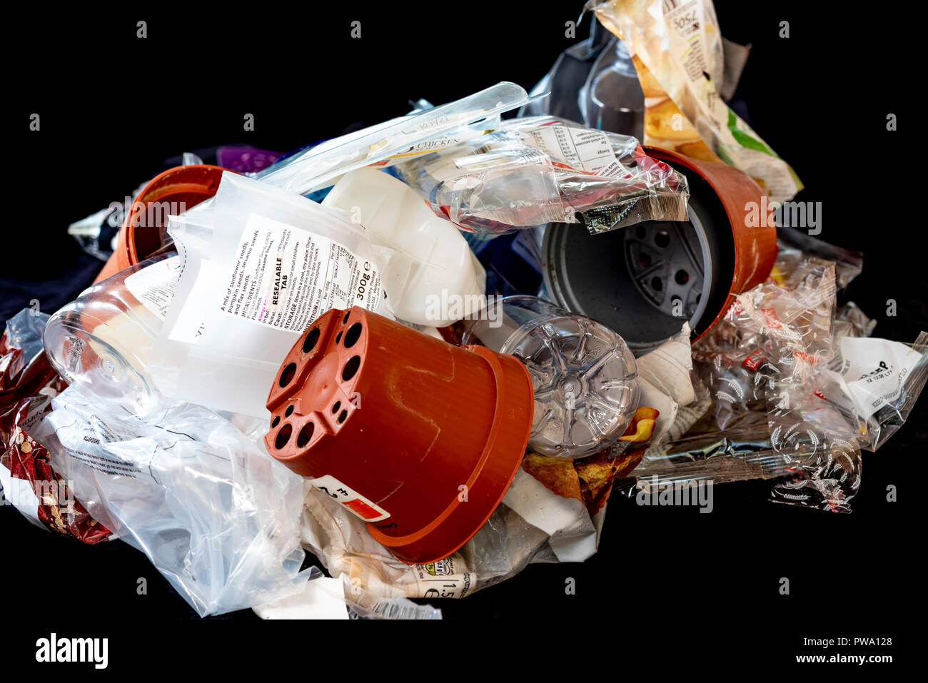 Pile of different plastics, some are recyclable some not. - Stock Image