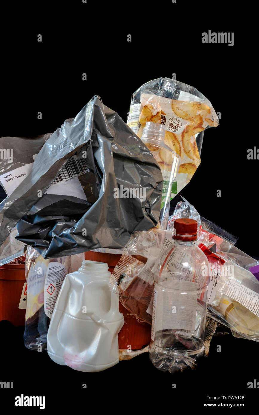 Pile of different plastics, some are recyclable some not. Stock Photo