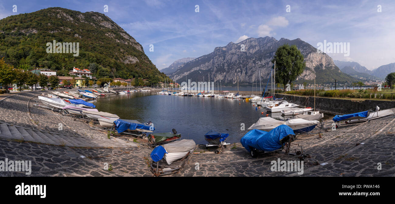 Boats at Valmedrera harbour on Lake Como, Italy, with mountainsStock Photo