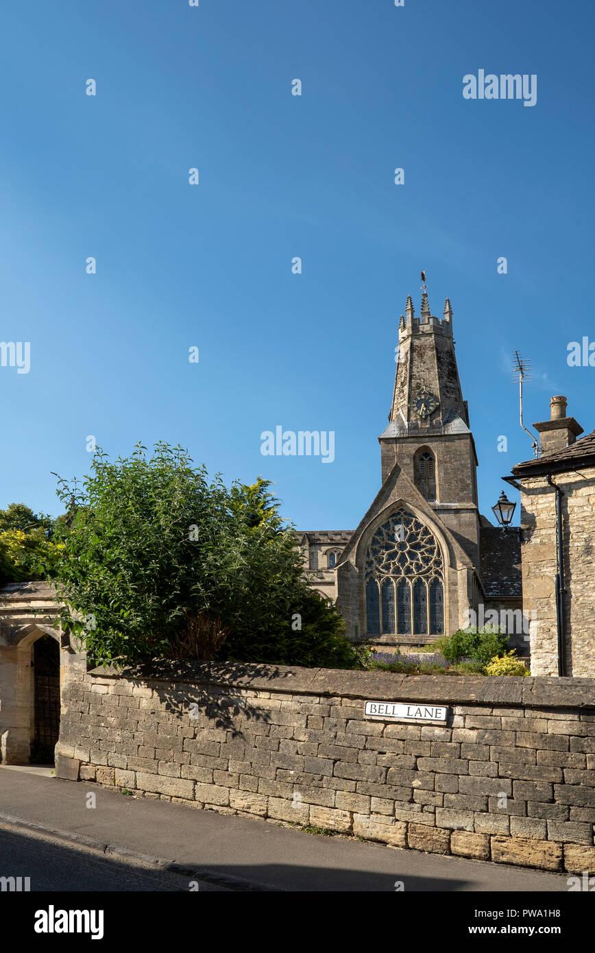 Holy Trinity Church, Bell Lane, Minchinhampton, Gloucestershire and its decorated period rose window. - Stock Image