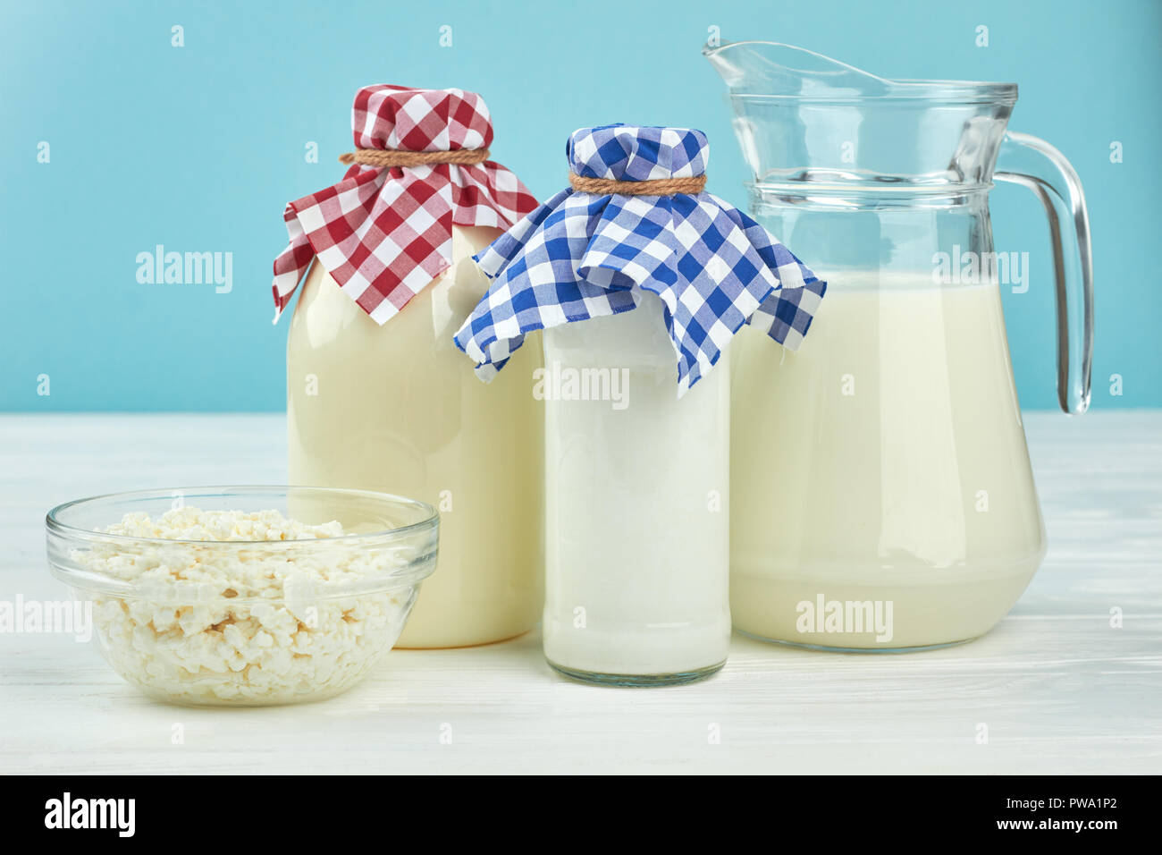 Dairy products background  Old-fashioned glass bottles with