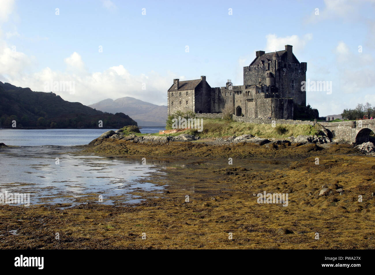 Eilean Donan castle, which dates back to the 13th century, sits on a small island in Loch Duich in Scotland. It is one of the most popular, most photographed castles in Scotland if not the United Kingdom. It has also made a few appearances in feature films. - Stock Image