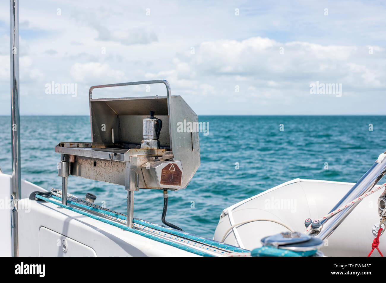 Coffee maker on barbecue attached to stern of a yacht at sea - Stock Image