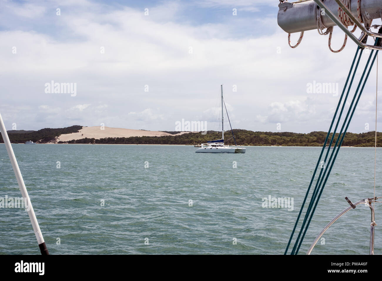Idyllic Moreton Island, Moreton Bay, Queensland Australia as viewed from the stern of a yacht. - Stock Image