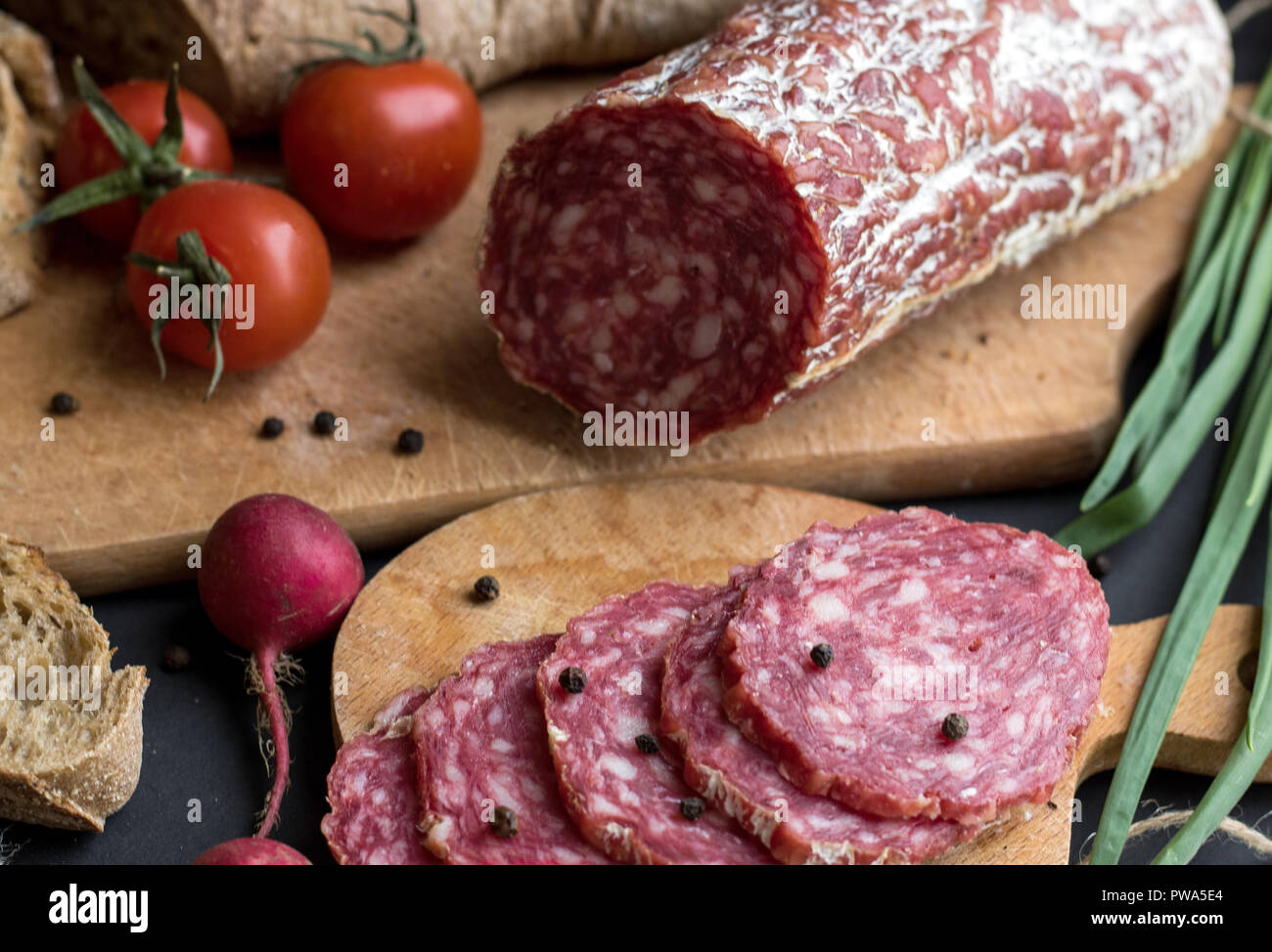 Close up sausage pieces with bread and potatoes - Stock Image