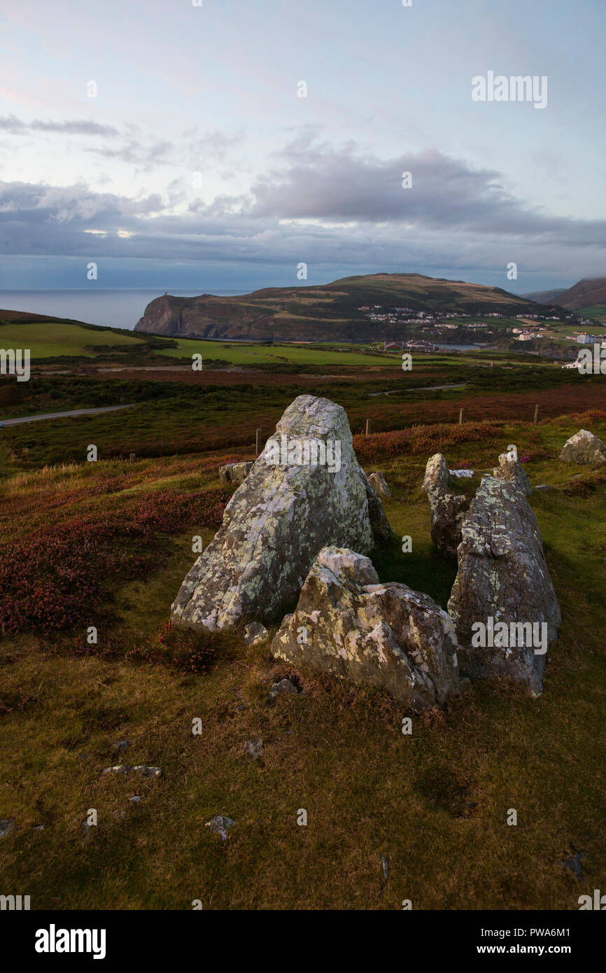 Meayll Stone Circle and burial chamber on Meayll Hill with view of Bradda Head, Port Erin, Isle of Man - Stock Image
