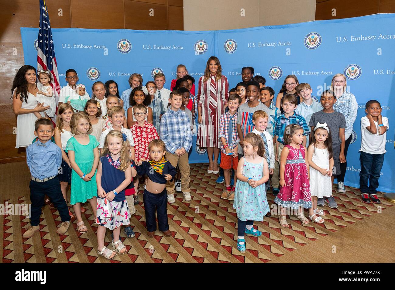 U.S First Lady Melania Trump poses for photos and meets with U.S. Embassy Ghana employees and their families at the Movenpick Ambassador Hotel October 2, 2018 in Accra, Ghana. This is the first solo international trip by the First Lady. - Stock Image