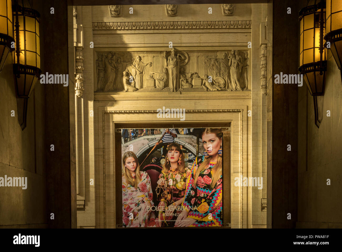 Milan - March 31: Dolce and Gabbana advertisement posted displayed on the walls of Milan Central railway station on March 31, 2018 in Milan, Italy. - Stock Image