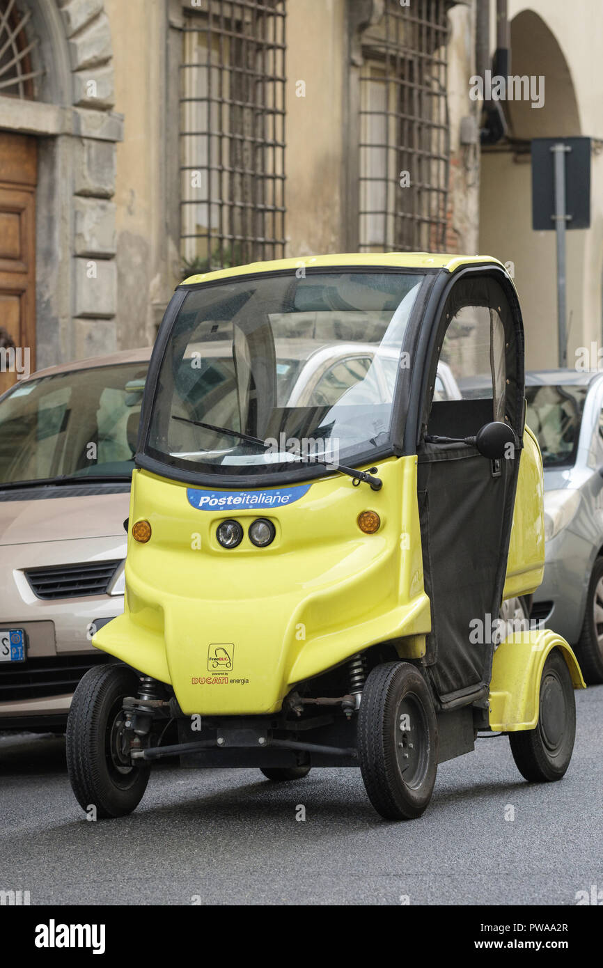 The local postmans electric vehicle, old town of Pistoia, Tuscany, Italy, Europe, - Stock Image