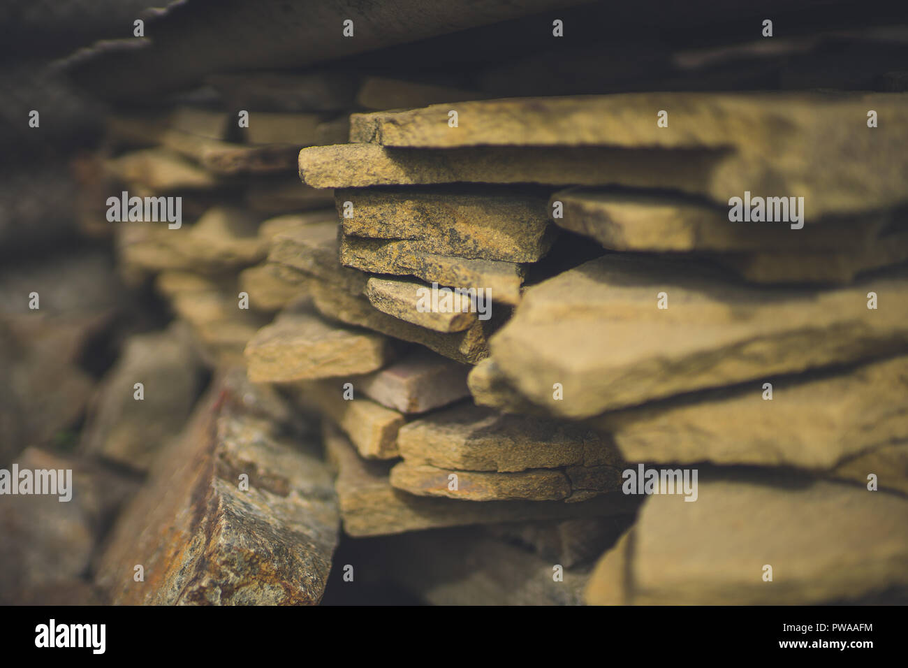 Folded old stone tiles for outdoor use. - Stock Image