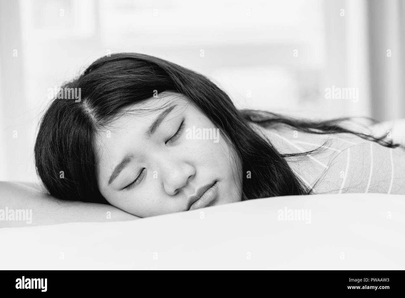teen sleeping black and white monotone - Stock Image
