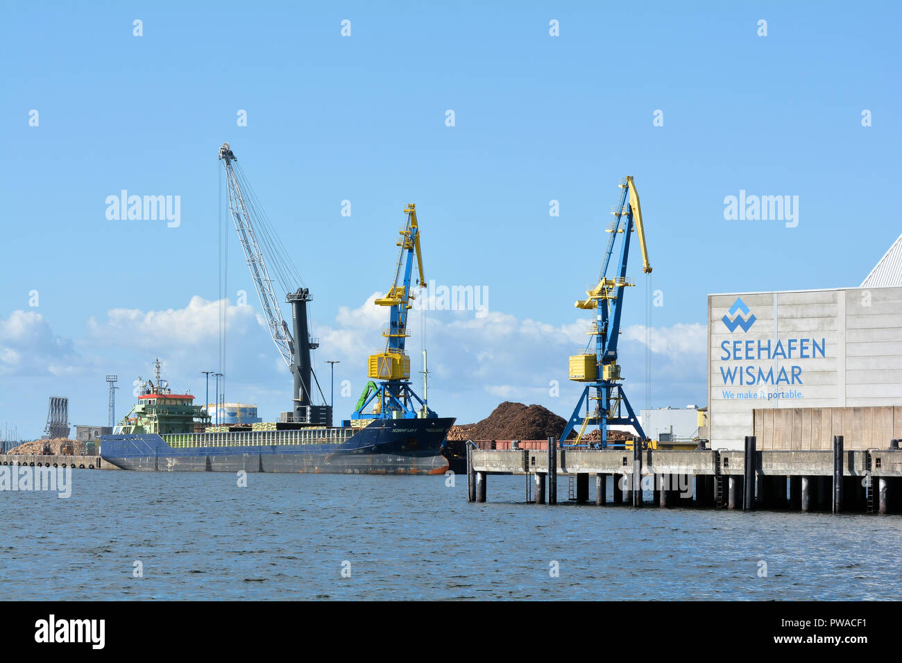 Cranes in the harbor of Wismar on the Baltic Sea - Stock Image