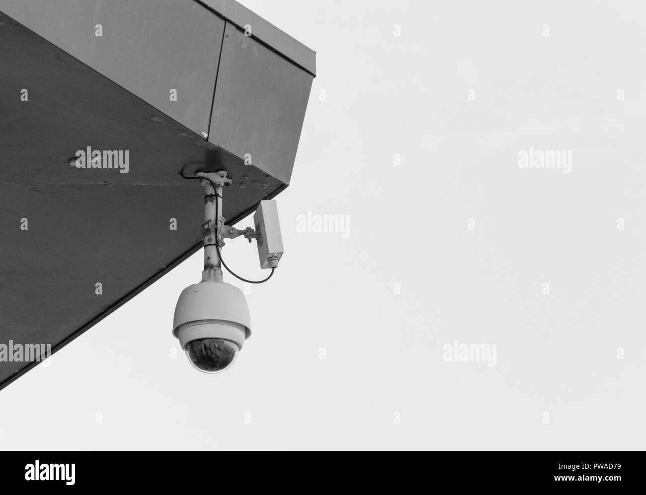 CCTV surveillance camera 'Watching Over You'. Crime prevention metaphor, surveillance state, security system concept. - Stock Image