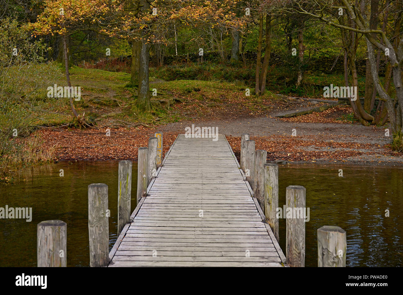 Wood jetty on Coniston Water, Lake District, UK Stock Photo
