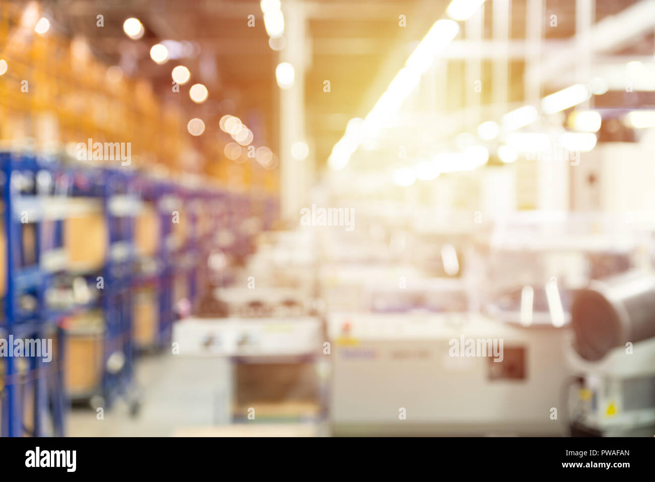 Abstract blurred manufacturing area at factory, industrial background Stock Photo
