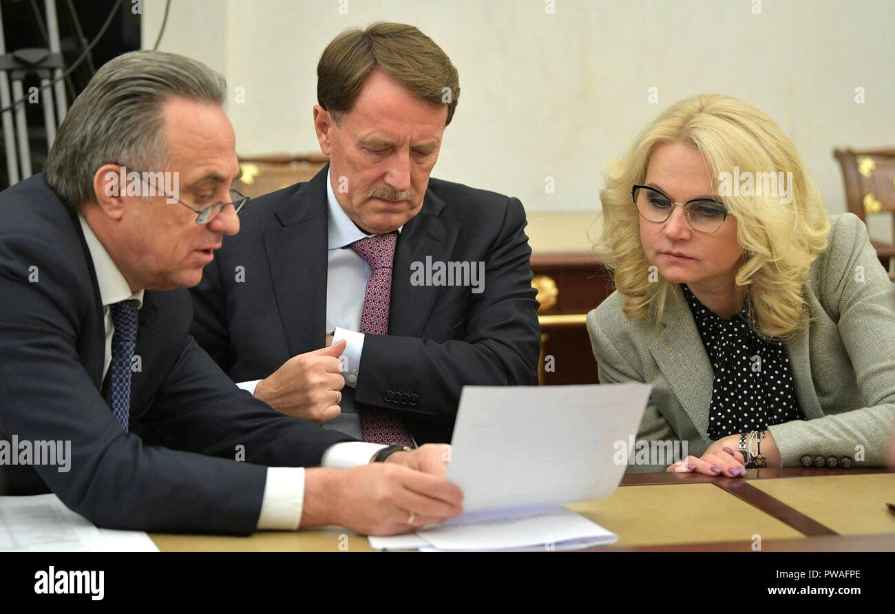Russian Deputy Prime Ministers Vitaly Mutko, left, Alexei Gordeyev and Tatyana Golikova, right, during a meeting of government members at the Kremlin October 11, 2018 in Moscow, Russia. - Stock Image