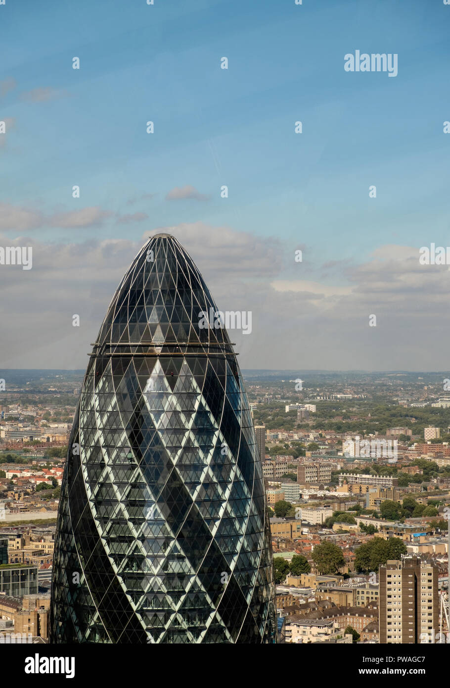 The Gherkin or 30 St Mary Axe is a commercial skyscraper in London's primary financial district, the City of London. It was completed in December 2003 - Stock Image