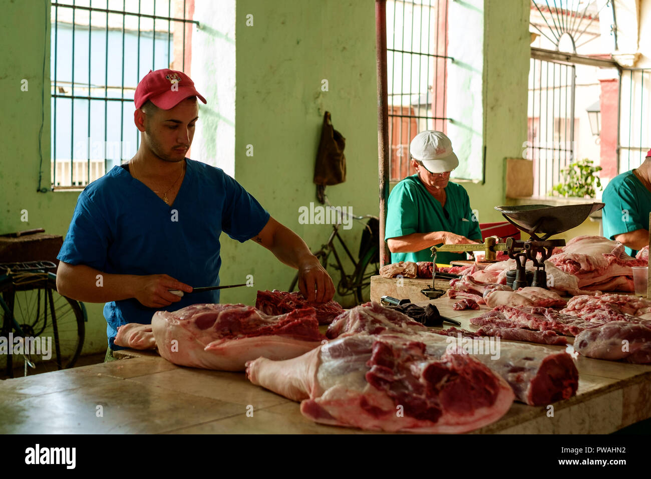 Meat Preparation in a Market in Sancti Spiritus, Cuba - Stock Image