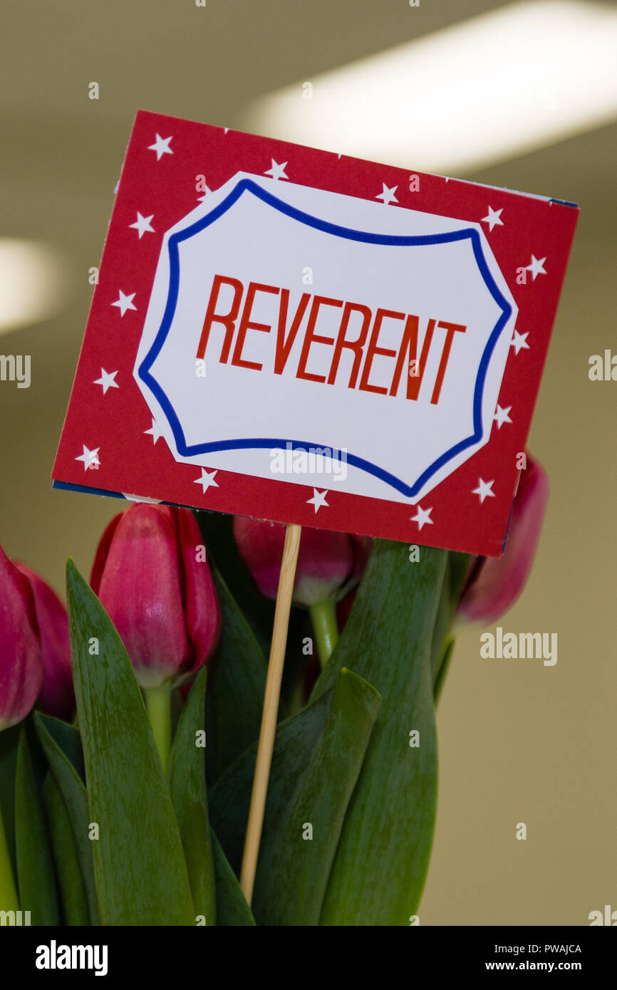 A Scout is reverent sign with flowers close - Stock Image