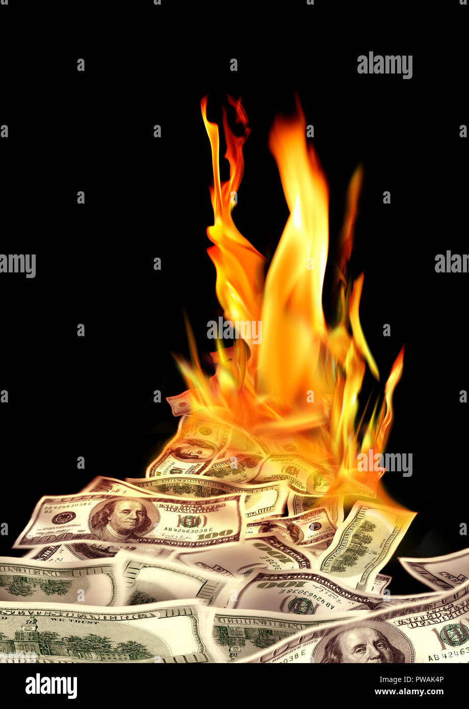 Conceptual finance image of burning pile of money, dollar bills ...