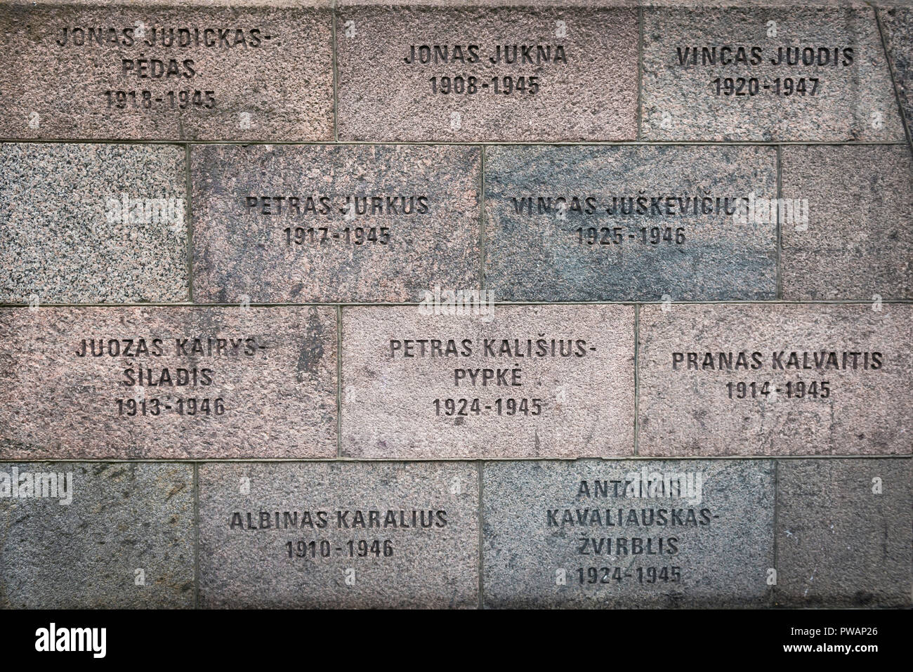 The Names of Lithuanians murdered during the Soviet and Nazi occupations inscribed on the exterior wall of the Museum Of Genocide Victims in Vilnius. - Stock Image