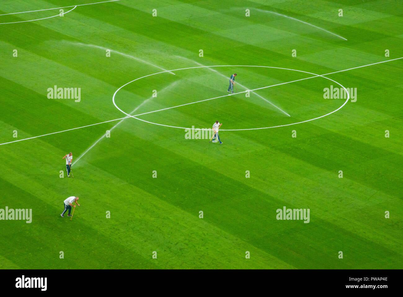 People setting up the field before a football match. Santiago Bernabeu stadium, Madrid, Spain. - Stock Image