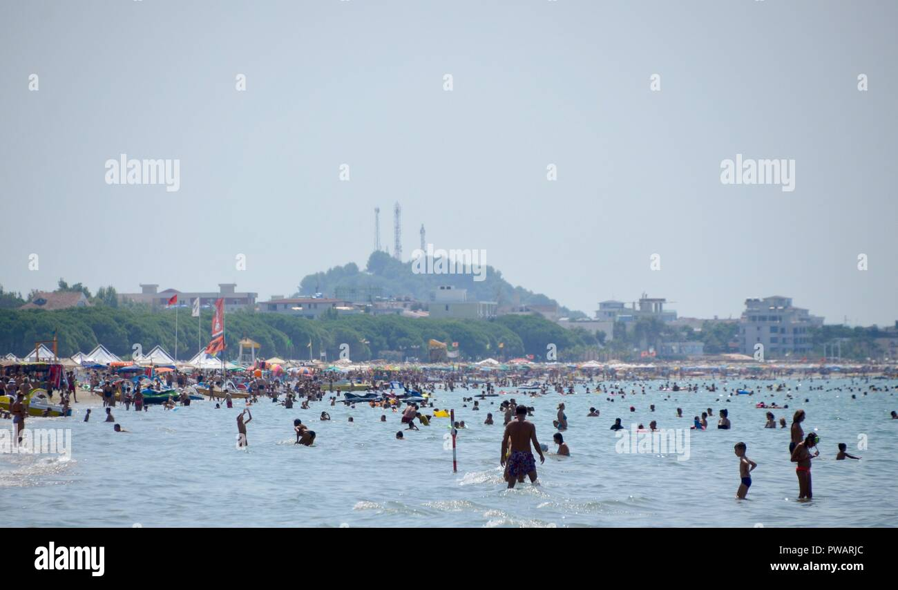the busy summer beach at durres albania - Stock Image