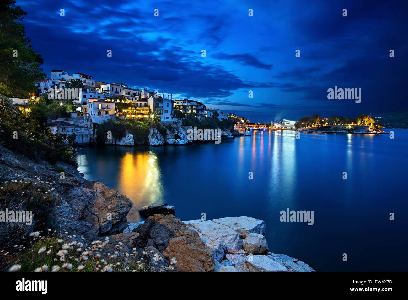 Night view of Plakes, the oldest neighborhood of Skiathos town, Skiathos island, Greece. To the right, you can see Bourtzi castle. Stock Photo