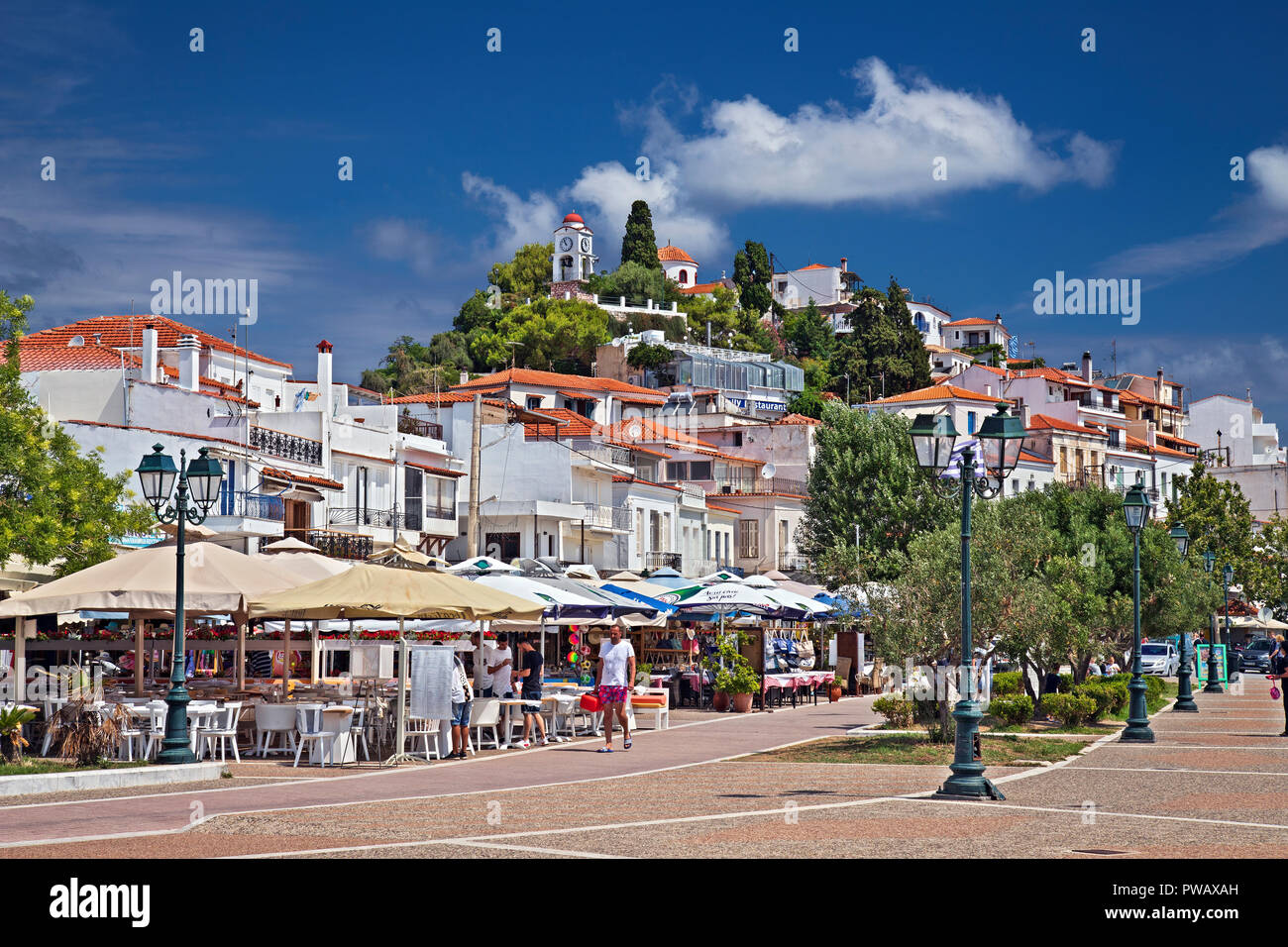 The church and the clock tower of Agios Nikolaos, one of the best viewpoints of Skiathos town, Skiathos island, Northern Sporades, Magnessia, Greece. - Stock Image