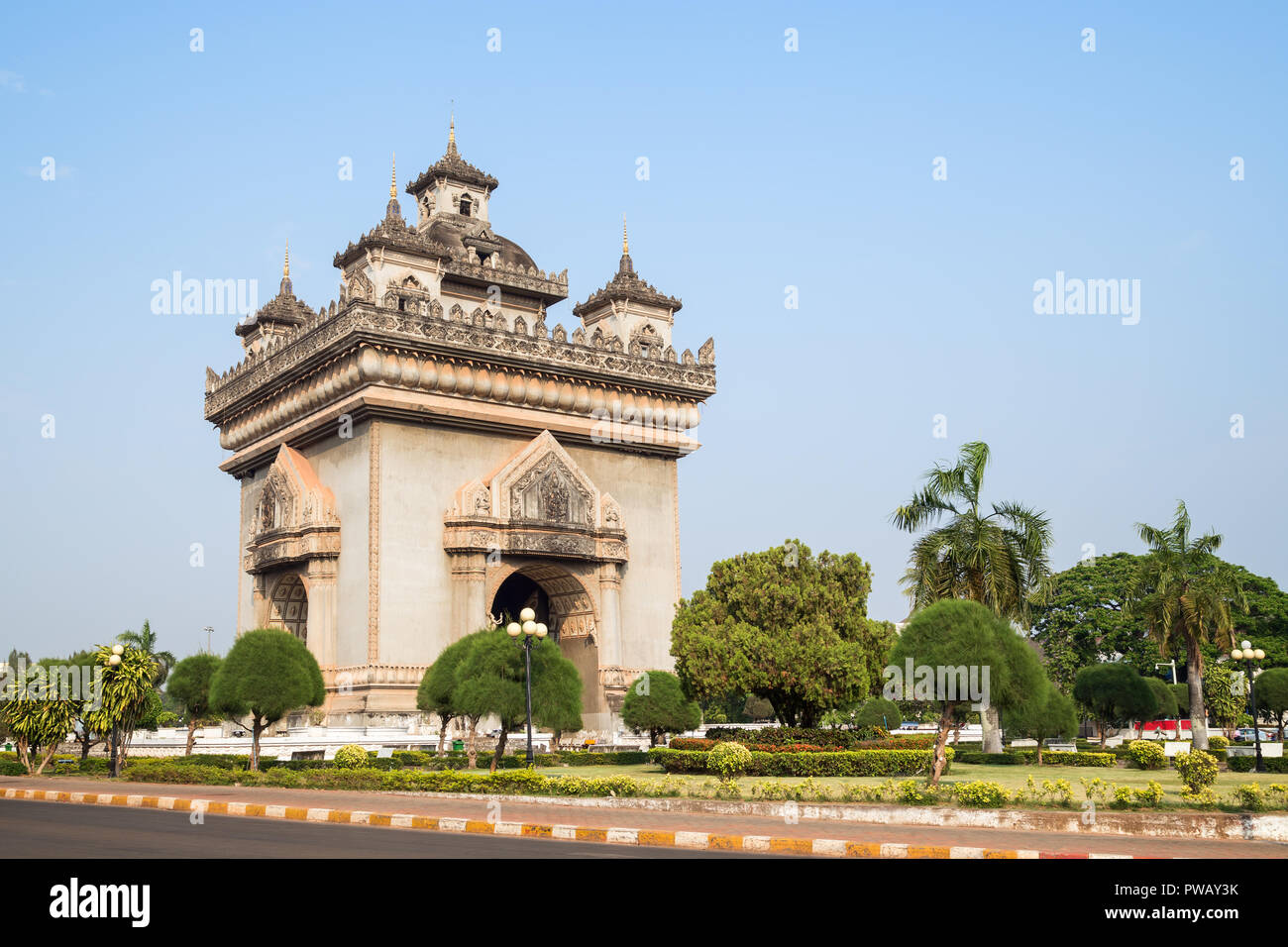 Patuxai (Patuxay), Victory Gate or Gate of Triumph, war monument and park in Vientiane, Laos, on a sunny day. - Stock Image