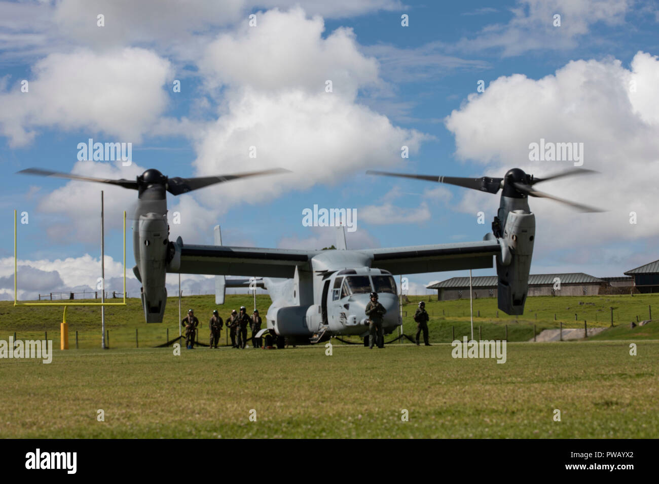 U.S. Marines with Marine Medium Tiltrotor Squadron 363 (VMM-363), arrive at the Waimea District Park arrive a day prior of the Waimea Fall Festival to set up a static display of one of their MV-22B Osprey, Oct. 12, 2018. VMM-363, nicknamed the Lucky Red Lions, flew one of their aircraft from Marine Corps Base Hawaii on Oahu to the Waimea Fall Festival, providing a static display and subject matter experts for a first-hand experience to the festival's attendants. The squadron arrived to Hawaii earlier this year increasing the combat capability and crisis response within the Indo-Pacific region. Stock Photo