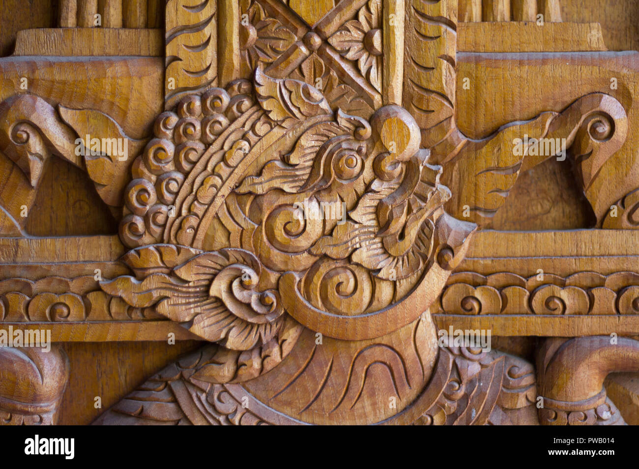 a wood carving depictiong image of a giant on the door of